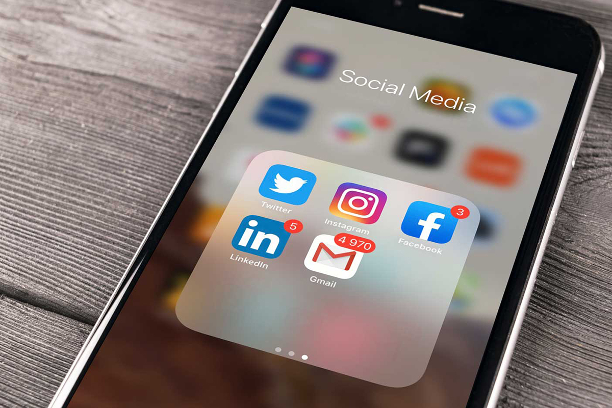Social media app icons on a smartphone